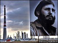 Fidel Castro poster in front of Camilo Cienfuegos refinery, Cuba