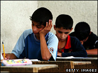 Iraqi boys take an exam in a school in Sadr City, Baghdad (29 May 2007)