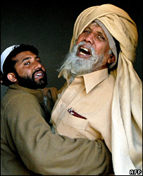 A man mourns the death of his two sons at the mosque in Charsadda (21 December 2007)