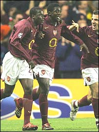 Emmanuel Eboue (right) and Kolo Toure (left)