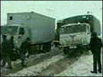 Lorries close to the site of the avalanche (still from Russia TV)