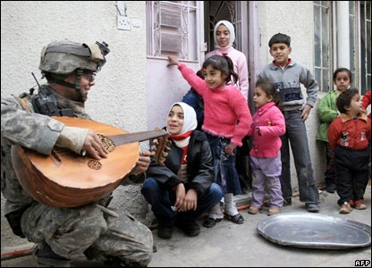 A US soldier plays in Sadr City
