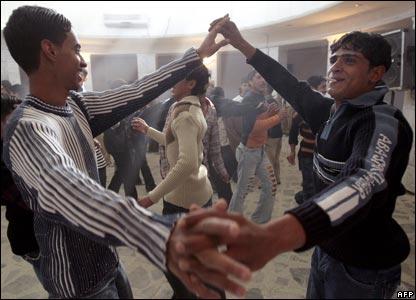 Men dance in al-Zawraa park in central Baghdad.