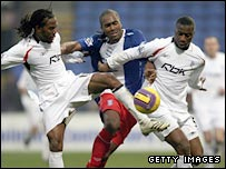 Cameron Jerome of Birmingham tries to squeeze through the middle of Bolton duo Ricardo Gardner and Abdoulaye Meite