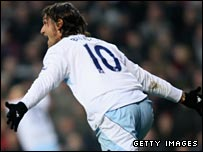 Rolando Bianchi wheels away after putting Man City ahead at Aston Villa
