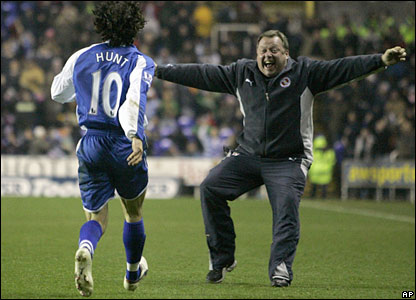 Reading assistant manager Wally Downes celebrates with Stephen Hunt