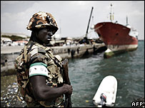 An African Union peacekeeper guards the Port of Mogadishu, 9 December