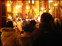 Worshippers attend a service in a state-approved Catholic church