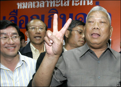 Samak Sundaravej, leader of the People's Power Party, flashes a victory sign on election day