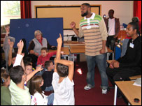 One of the singers from Blind Alphabetz works with children in the classroom