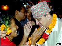 King Gyanendra of Nepal (R) is greeted by supporters during his visit to the Nawa Durga Hindu Temple in Bhaktapur on the outskirts of Kathmandu.