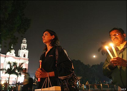 Worshippers light candles outside Sacred Heart Cathedral, Delhi