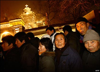 Worshippers line up outside a government approved Catholic church in Beijing