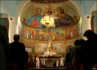 Palestinian Christians attend the Christmas mass at the Latin Catholic Church in Gaza City