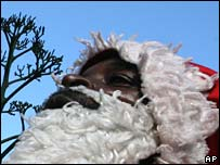 A Father Christmas waits for a photo opportunity with children in Harare on Monday