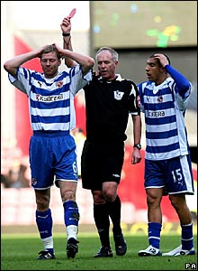 Reading's Brynjar Gunnarsson (left) is shown the red card by referee Peter Walton