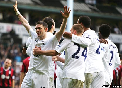 Robbie Keane celebrates scoring his goal