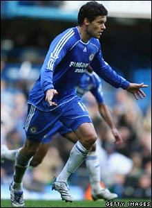 Michael Ballack celebrates scoring his free-kick