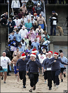 """Fancy dress swimmers charged into the North Sea for the Aberdeen Lions Club """"Nippy Dipper"""" event."""