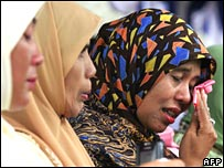 A woman weeps as she remembers the tsunami in Aceh, Indonesia, on Wednesday 26 December 2007