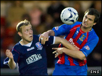 Falkirks' Scott Arfield tussles with Inverness's Marius Niculae