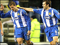 Ryan Taylor (left) celebrates his winning goal