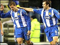 Ryan Taylor (left) celebrates his winning goal