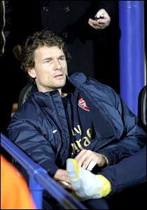 Arsenal keeper Jens Lehmann sits on the bench at Fratton Park