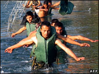 Nepalese soldiers search for missing people in the Bheri River 26/12