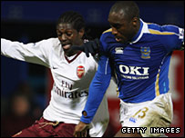 Arsenal's Emmanuel Adebayor (left) and Portsmouth's Sol Campbell