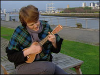Woman playing a ukelele