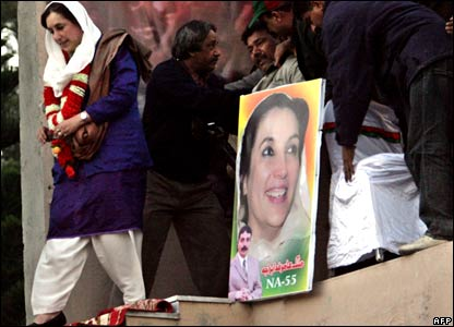Pakistani former premier Benazir Bhutto leaves the stage after her last election campaign rally in Rawalpindi.