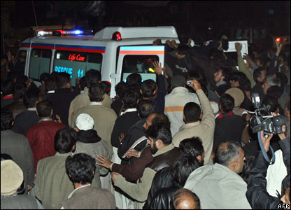 The ambulance carrying Ms Bhutto's coffin