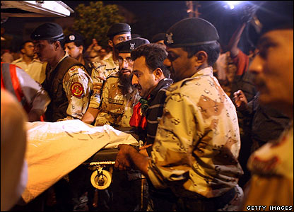 Benazir Bhutto's coffin is loaded into an ambulance