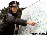 San Francisco Police Chief Heather Fong points out the tiger enclosure