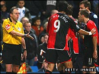 Blackburn players question the assistant referee's decision