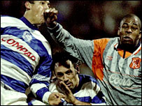 Chelsea's Michael Duberry (r) challenges QPR's Mark Hateley (c) and Nigel Quashie in 1996