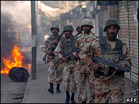 Troops patrol a street in Karachi on 28 December