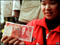 A woman holding a 100 yuan bank note