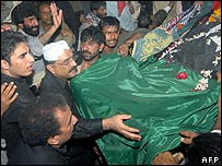 Benazir Bhutto's coffin is carried by her husband and PPP supporters