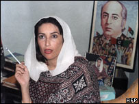 Benazir Bhutto in 1988 in front of her father's portrait