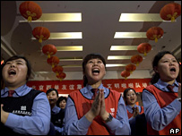 "Members of the ""Beijing Civilised Workers Cheering Squad"" practise their cheering (28 November 2007)"