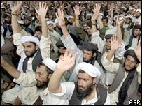 Taleban supporters listen to a Mansoor Dadullah speech