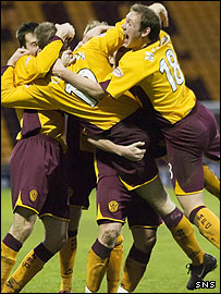 Motherwell players celebrate David Clarkson's excellent second goal