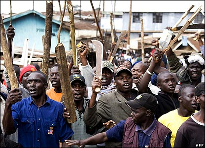 Supporters of Raila Odinga waving knives and sticks