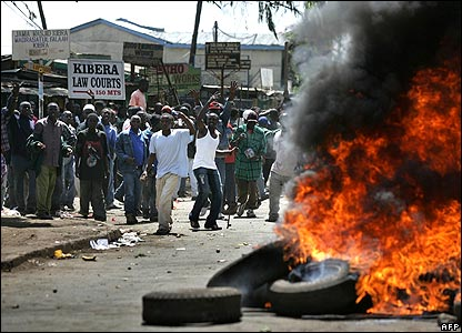 Raila Odinga supporters near burning tyres