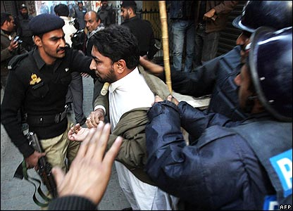 Police arresting man in Rawalpindi