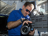 John Grundfeld holds a camera on the aft flight deck of space shuttle Columbia  Image: Nasa