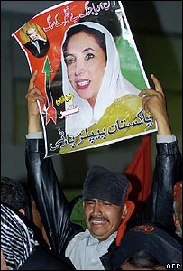 A supporter holds up a picture of Benazir Bhutto