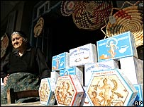 Woman selling goods at a stall